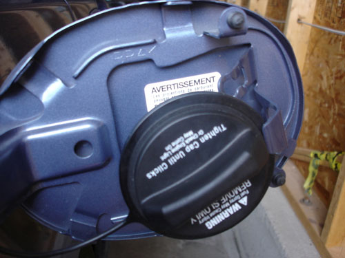 Store a Mazda3 Gas Cap While Filling